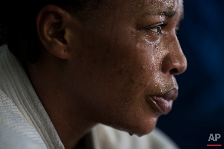 In this May 26, 2016 photo, Yolande Mabika, a refugee from the Democratic Republic of Congo, takes a break during Judo training at the Reacao Institute in Rio de Janeiro, as she trains in hopes of making the cut for the first Olympic team of refugee athletes. In 2013, Mabika and another judo athlete from Congo traveled to Brazil with the team to compete at the World Judo Championships. They say officials left them at their downtown Rio hotel for three days prior to the competition without food, money or passports. (AP Photo/Felipe Dana)