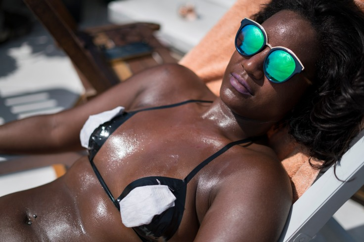 In this Jan. 11, 2017 photo, a woman tans while using bikinis made out of electrical tape on the rooftop of the Erika Bronze salon in the suburb of Realengo in Rio de Janeiro, Brazil. While women in some European countries sunbathe topless to avoid tan lines, in Rio these women pay up to US$20 (70 Brazilian reais) a session to get sharp ones that contrast with their gleaming golden brown skin. (AP Photo/Renata Brito)