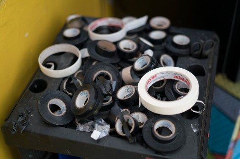 In this Jan. 11, 2017 photo, rolls of electrical tape are seen at the Erika Bronze rooftop salon in the suburb of Realengo in Rio de Janeiro, Brazil. Bikinis made out of black electrical tape are applied directly to the skin, which after an hour of broiling sun get peeled back to reveal crisp tan lines. (AP Photo/Renata Brito)